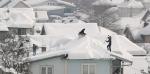 Nuo stogo nenuvalytas sniegas grasina nuostoliais